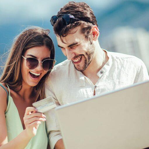 Romantic couple using total resort vacation reward credits by The Villa Group Resorts